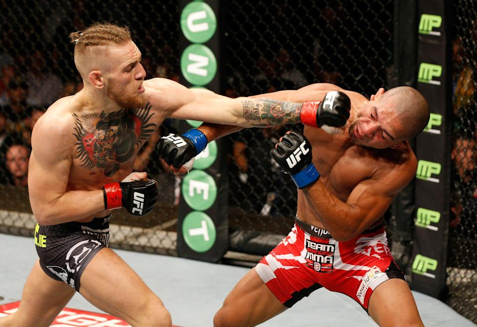 Conor McGregor lands a left to the head of Diego Brandao in their featherweight bout during the UFC Fight Night event at The O2 Dublin on July 19, 2014. (Getty Images)