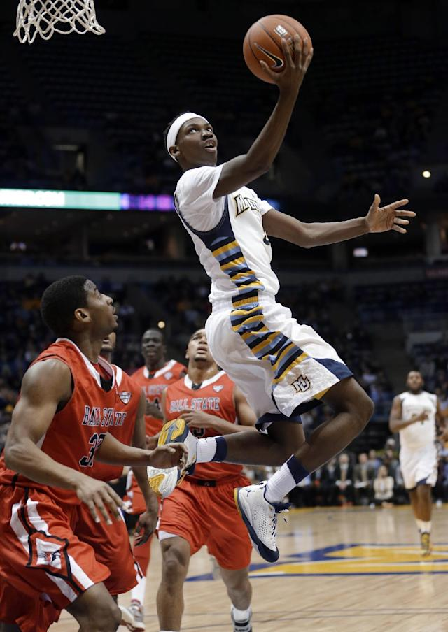 Marquette's JaJuan Johnson puts up a shot during the first half of an NCAA college basketball game against Ball State on Tuesday, Dec. 17, 2013, in Milwaukee. (AP Photo/Morry Gash)