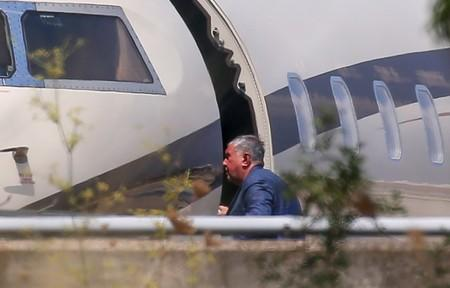 View shows a passenger, believed to be Chief Executive of Rosneft Igor Sechin, boarding a Rosneft-operated aircraft at Palma de Mallorca airport