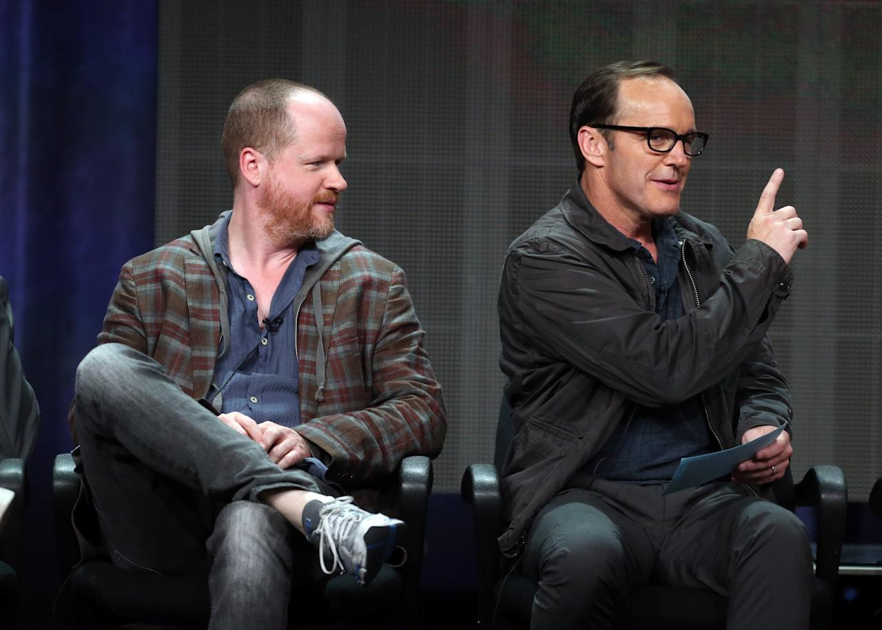 "BEVERLY HILLS, CA - AUGUST 04: Writer/director Joss Whdeon (L) and actor Clark Gregg speak onstage during the ""Agents of S.H.I.E.L.D."" panel discussion at the Disney/ABC Television Group portion of the Television Critics Association Summer Press Tour at the Beverly Hilton Hotel on August 4, 2013 in Beverly Hills, California. (Photo by Frederick M. Brown/Getty Images)"