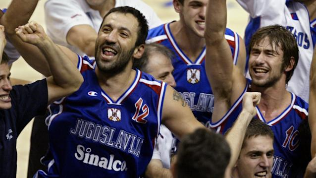 Vlade Divac (left) cheers after Yugoslavia wins the 2002 FIBA World Cup in Indianapolis