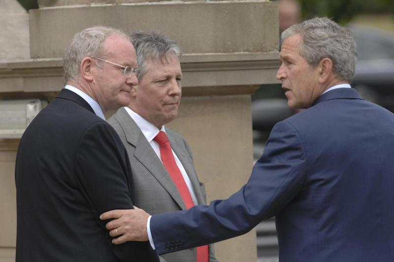 Political meetings: Martin McGuinness and First Minister Peter Robinson with former US President George Bush (PA)