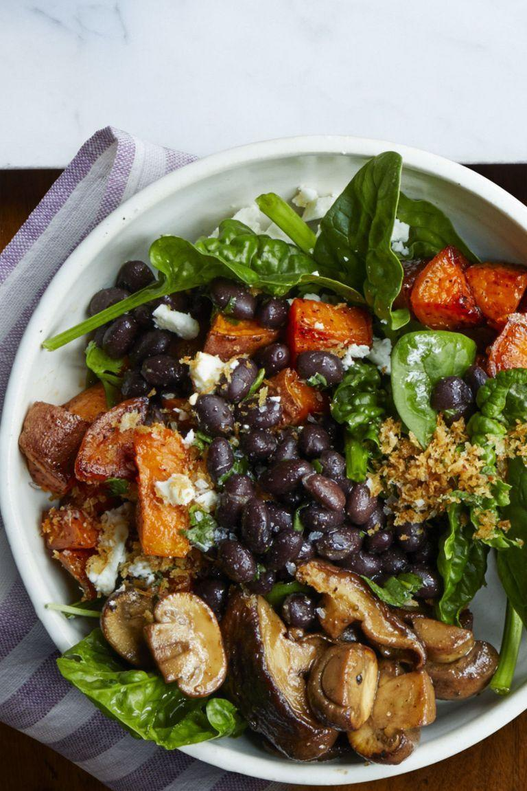 """<p>Who says vegetables can't be hearty? With meaty mushrooms and protein-packed black beans, this bowl makes for a substantial mean that won't leave you feeling groggy.</p><p><em><a href=""""https://www.womansday.com/food-recipes/food-drinks/recipes/a61046/roasted-vegetable-bowl-recipe/"""" rel=""""nofollow noopener"""" target=""""_blank"""" data-ylk=""""slk:Get the Roasted Vegetable Bowl recipe."""" class=""""link rapid-noclick-resp"""">Get the Roasted Vegetable Bowl recipe.</a></em></p>"""