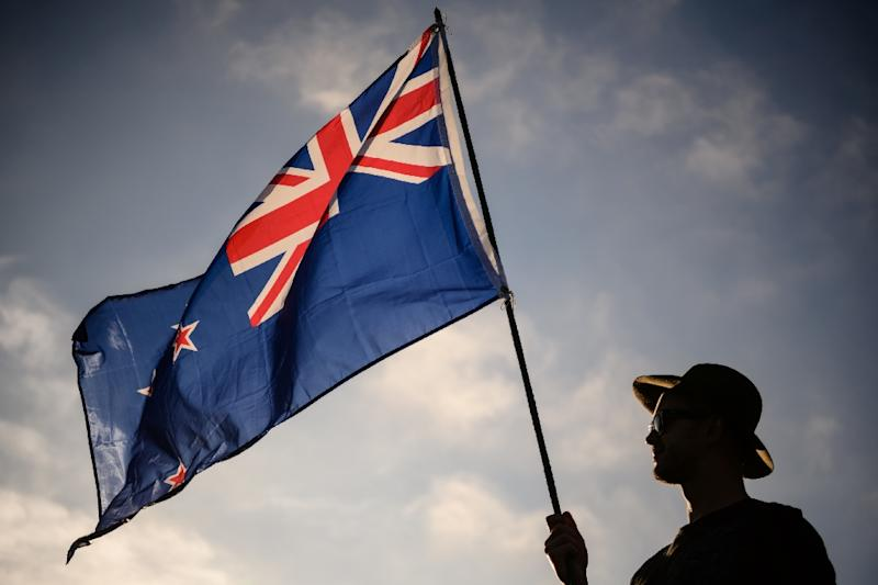 A New Zealand flag held at a vigil for the Christchurch mosque massacres. New Zealand has offered permanent residency to those directly affected by the attacks