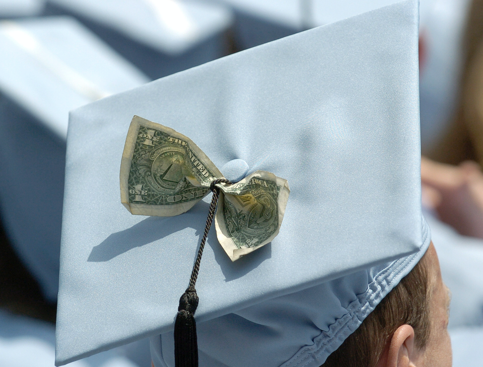 Graduates receive a Masters in Business Administration from Columbia University in New York, May 18, 2005. (Photo: REUTERS/Chip East)