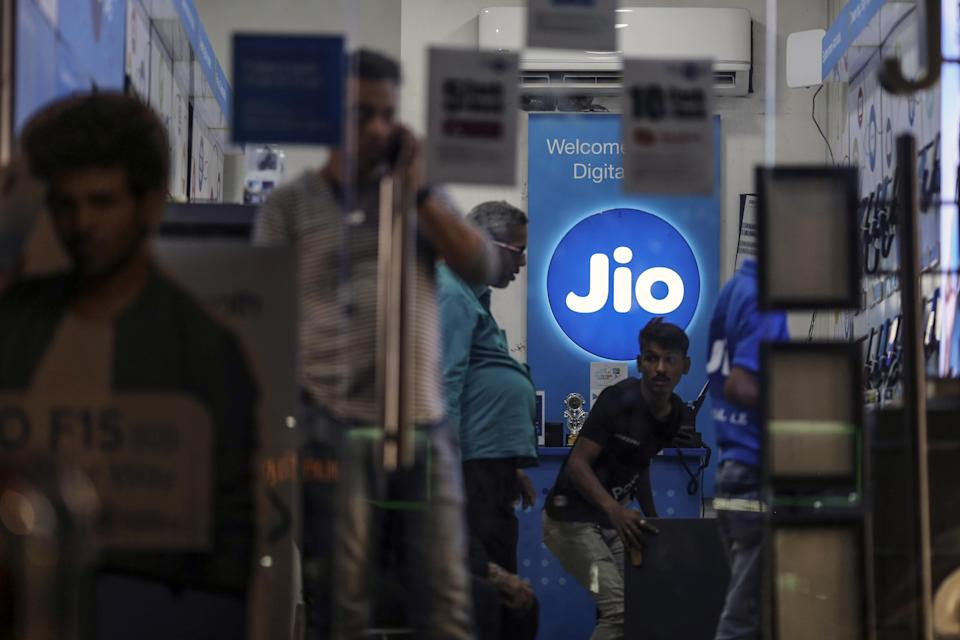 The logo of Reliance Jio, the mobile network of Reliance Industries Ltd., is displayed inside a store in Mumbai, India, on Sunday, Jan. 19, 2020. Reliance Industries, India's biggest company by market value, posted a 13.5% jump in quarterly net income as growth in telecom and retail business helped outweigh a slump in petrochemical operations. Photographer: Dhiraj Singh/Bloomberg via Getty Images