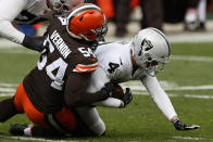 Cleveland Browns defensive end Olivier Vernon (54) sacks Las Vegas Raiders quarterback Derek Carr (4) during the first half of an NFL football game, Sunday, Nov. 1, 2020, in Cleveland. (AP Photo/Ron Schwane)