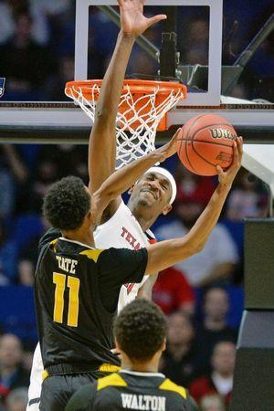 Mar 22, 2019; Tulsa, OK, USA; Texas Tech Red Raiders forward Tariq Owens (11) blocks the shot of Northern Kentucky Norse guard Jalen Tate (11) during the second half in the first round of the 2019 NCAA Tournament at BOK Center. The Texas Tech Red Raiders won 72-57. Mandatory Credit: Brett Rojo-USA TODAY Sports