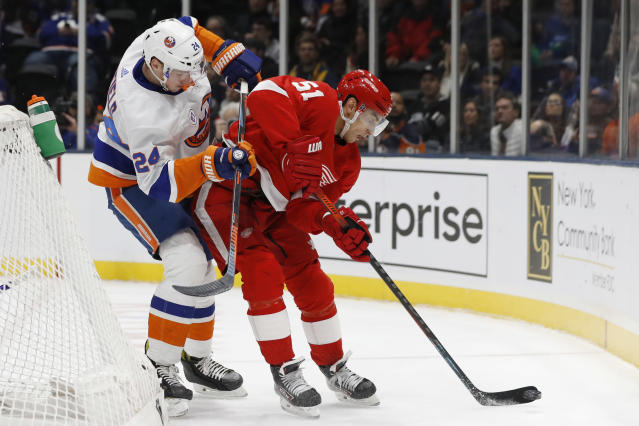 New York Islanders defenseman Scott Mayfield (24) defends against Detroit Red Wings center Valtteri Filppula (51) behind the Islanders' net during the first period of an NHL hockey game Friday, Feb. 21, 2020, in Uniondale, N.Y. (AP Photo/Kathy Willens)