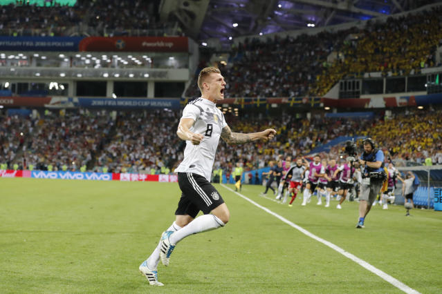 Germany's Toni Kroos celebrates after he scoring the winner from just inside the penalty box