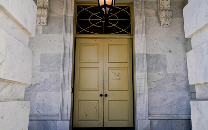 """One of Trump's supporters wrote """"murder the media"""" on a door to the US Capitol - REUTERS"""