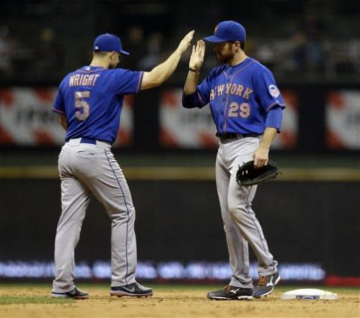 New York Mets' Ike Davis (29) and David Wright (5) celebrate their win after a baseball game against the Milwaukee Brewers Friday, July 5, 2013, in Milwaukee. The Mets won 12-5. (AP Photo/Morry Gash)