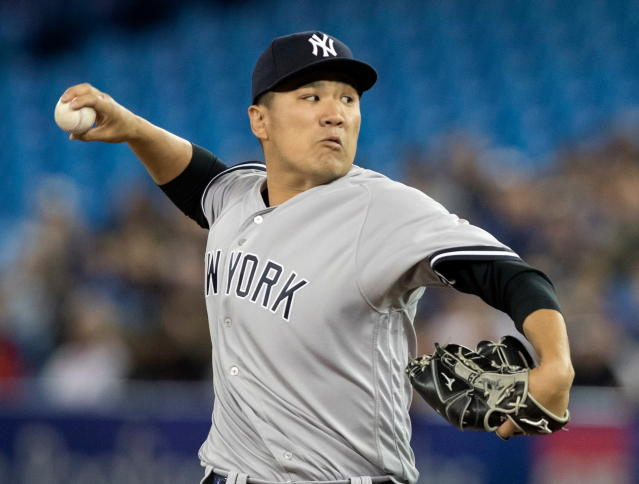 New York Yankees starting pitcher Masahiro Tanaka throws during the first inning of a baseball game against the Toronto Blue Jays in Toronto, Friday, March 30, 2018. (Fred Thornhill/The Canadian Press via AP)