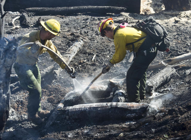 <p>Firefighters from Utah Division of Forestry, Fire and State Lands work on hot spots from yesterday's fire in Moab, Utah. Wednesday, June 13, 2018. (Photo: Rick Egan/The Salt Lake Tribune via AP) </p>