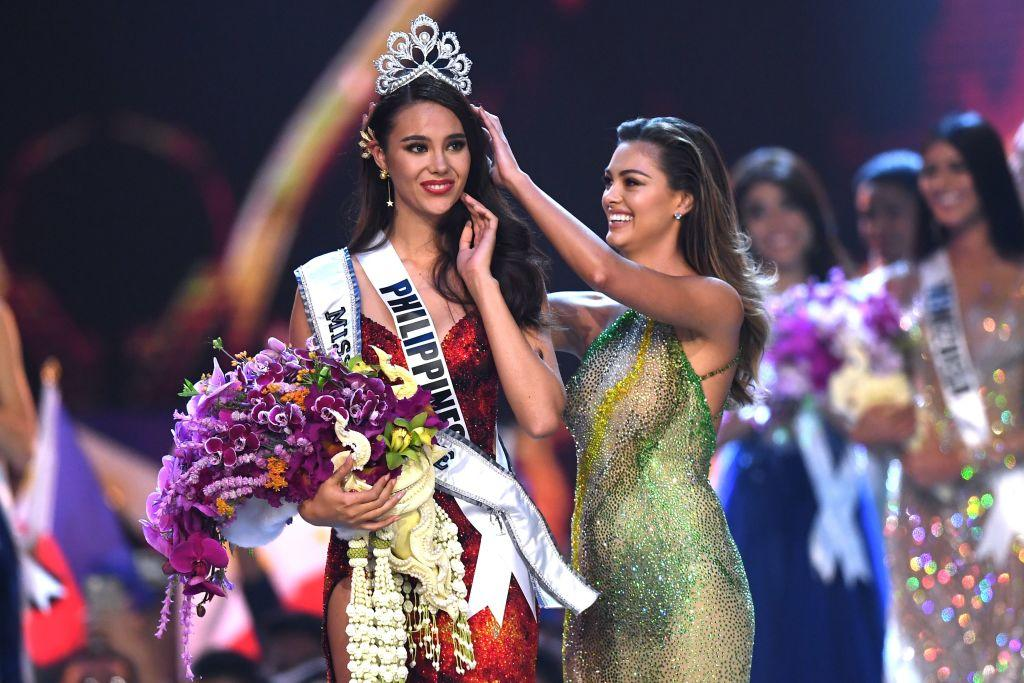 <p>Catriona Gray of the Philippines reacts as she is crowned the new Miss Universe 2018 by Miss Universe 2017 Demi-Leigh Nel-Peters. (Photo credit: LILLIAN SUWANRUMPHA/AFP/Getty Images) </p>