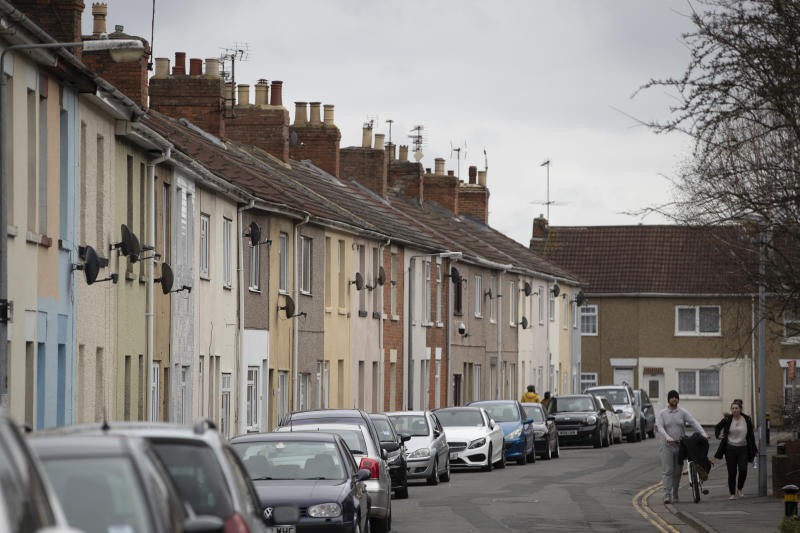 SWINDON, ENGLAND - FEBRUARY 20: A couple walk past a row of terraced housing near the town centre on February 20, 2019 in Swindon, England. The car manufacturer Honda announced on Tuesday it is to shut down the Swindon plant in 2022, putting 3,500 jobs at risk. The factory is Honda's only EU plant and has produced the Honda's 'Civic' model for over 24 years, with 150,000 of the cars rolling off the line annually. The manufacturer is a major employer in the town of around 220,000 and sits on the M4 corridor between London to the East and Bristol to the West. In 1986 one of the towns last major employers GWR (Great Western Railway) closed it's doors after a 140 year history of Railway locomotive manufacture putting around 1,500 people out of work. (Photo by Dan Kitwood/Getty Images)