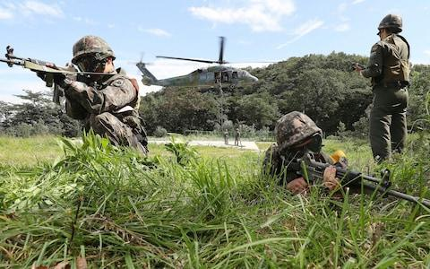 South Korean army soldiers aim their machine guns during the annual Ulchi Freedom Guardian exercise in Yongin, South Korea - Credit: Hong Gi-won/Yonhap via AP