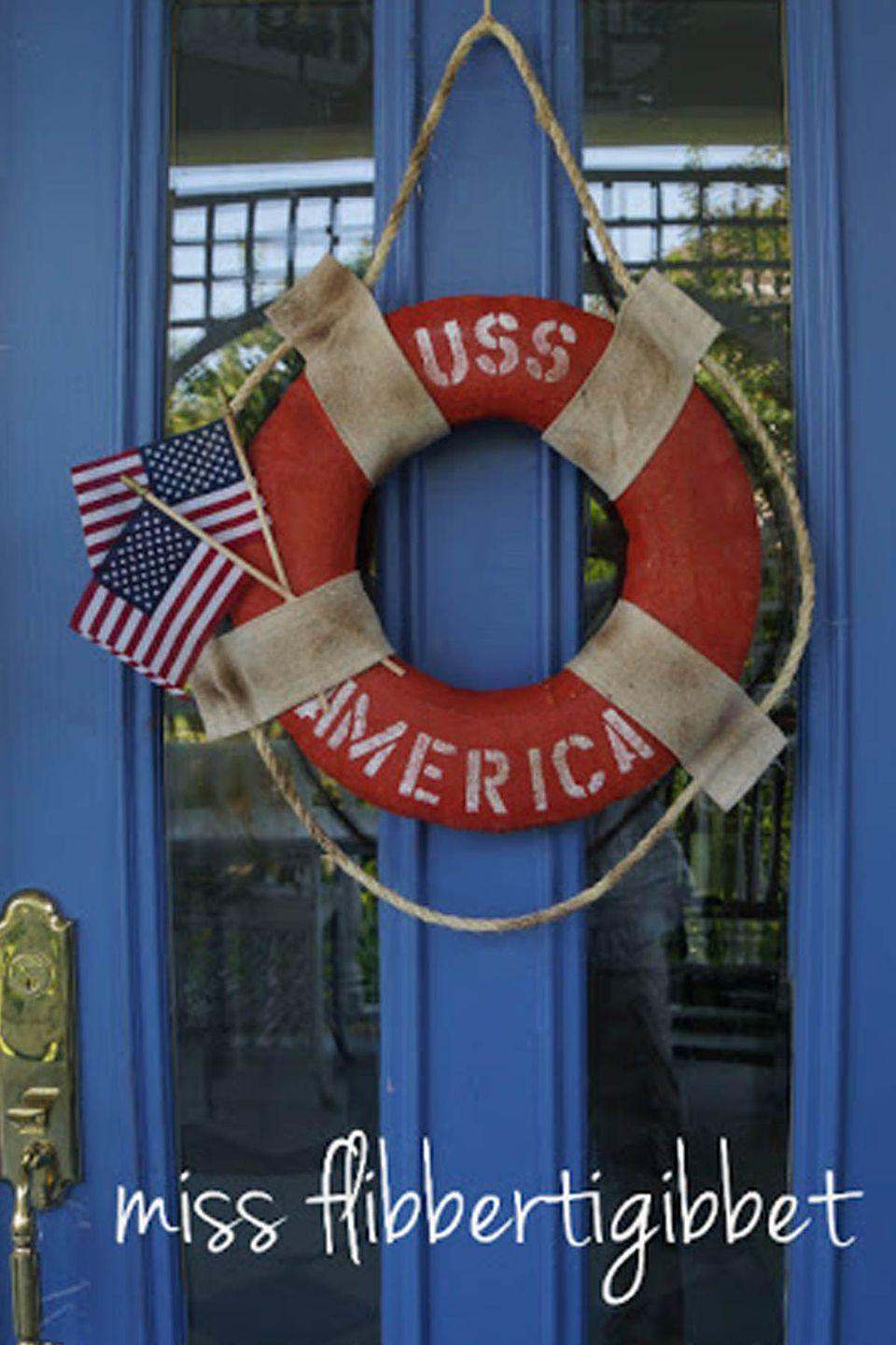 """<p>Infuse some nautical flair into your Independence Day decorations with this easy DIY project.</p><p><strong>Get the tutorial at <a href=""""http://www.missflibbertigibbet.com/2012/06/uss-america-and-my-first-linky-party.html"""" rel=""""nofollow noopener"""" target=""""_blank"""" data-ylk=""""slk:Miss Flibbertigibbet"""" class=""""link rapid-noclick-resp"""">Miss Flibbertigibbet</a>. </strong></p><p><strong><a class=""""link rapid-noclick-resp"""" href=""""https://www.amazon.com/Hampton-Nautical-Lifering-20-Red/dp/B00GA1XD1G/ref=pd_day0_5/132-5774707-0562635?pd_rd_w=4X3cB&pf_rd_p=8ca997d7-1ea0-4c8f-9e14-a6d756b83e30&pf_rd_r=BCSBAQDESBQR3BDWA7KV&pd_rd_r=98f2c9cb-c78d-42b1-b885-8fbdb9db2685&pd_rd_wg=Nv7qI&pd_rd_i=B00GA1XD1G&psc=1&tag=syn-yahoo-20&ascsubtag=%5Bartid%7C10050.g.4464%5Bsrc%7Cyahoo-us"""" rel=""""nofollow noopener"""" target=""""_blank"""" data-ylk=""""slk:SHOP LIFE RINGS"""">SHOP LIFE RINGS</a><br></strong></p>"""