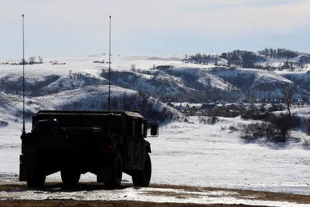 A North Dakota National Guard vehicle idles on the outskirts of the Dakota Access oil pipeline protest camp near Cannon Ball
