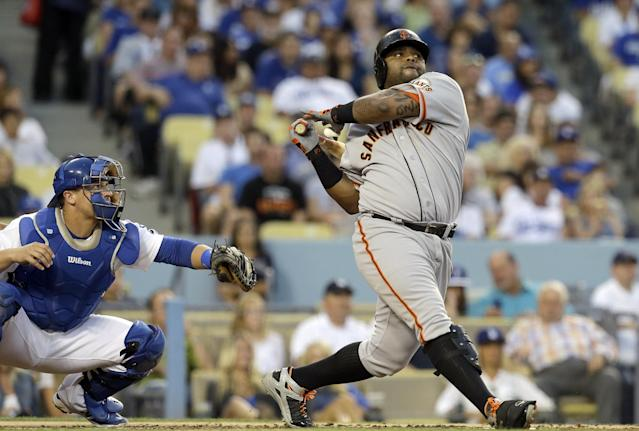 San Francisco Giants' Pablo Sandoval follows through on a two-run hit against the Los Angeles Dodgers and as catcher Tim Federowicz watches during the second inning of a baseball game in Los Angeles on Saturday, Sept. 14, 2013. (AP Photo/Reed Saxon)