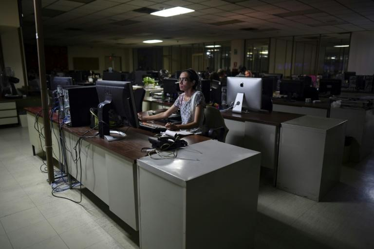 The editorial room at the Panorama newspaper, which ceased circulating in a physical form in May, is virtually deserted (AFP Photo/YURI CORTEZ)