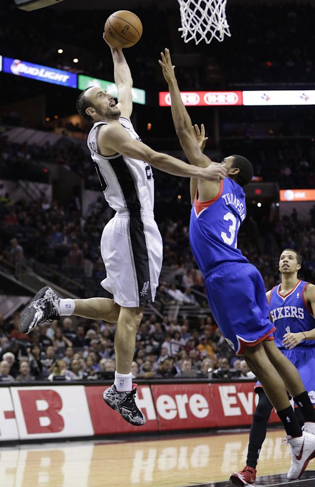San Antonio Spurs' Manu Ginobili (20), of Argentina shoots over 76ers' Hollis Thompson (31) during the first half of an NBA basketball game, Monday, March 24, 2014, in San Antonio. (AP Photo/Eric Gay)