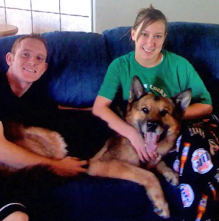 In a 2008 photo released by Eielson Air Force Base in Alaska, Airman Ashli McEntee is pictured with her then husband, Sgt. 1st Class Timothy McEntee, after they had adopted her military working dog.