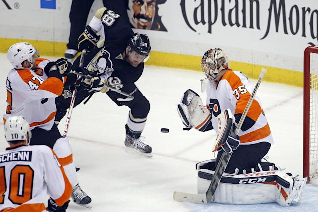 Pittsburgh Penguins' Harry Zolnierczyk (39) can't get to a rebound in front of Philadelphia Flyers goalie Steve Mason (35) during the first period of an NHL hockey game in Pittsburgh, Saturday, April 12, 2014. (AP Photo/Gene J. Puskar)