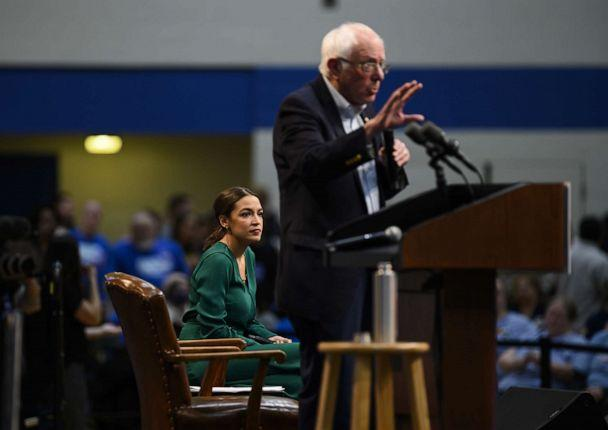 PHOTO: Sen. Bernie Sanders, I-Vt., and Rep. Alexandria Ocasio-Cortez, D-N.Y., field questions from audience members at the Climate Crisis Summit at Drake University Nov. 9, 2019 in Des Moines, Iowa. (Stephen Maturen/Getty Images)