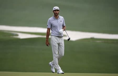 Dustin Johnson of the U.S. walks on the 10th green during Wednesday practice rounds for the 2017 Masters at Augusta National Golf Club in Augusta, Georgia, U.S., April 5, 2017. REUTERS/Lucy Nicholson
