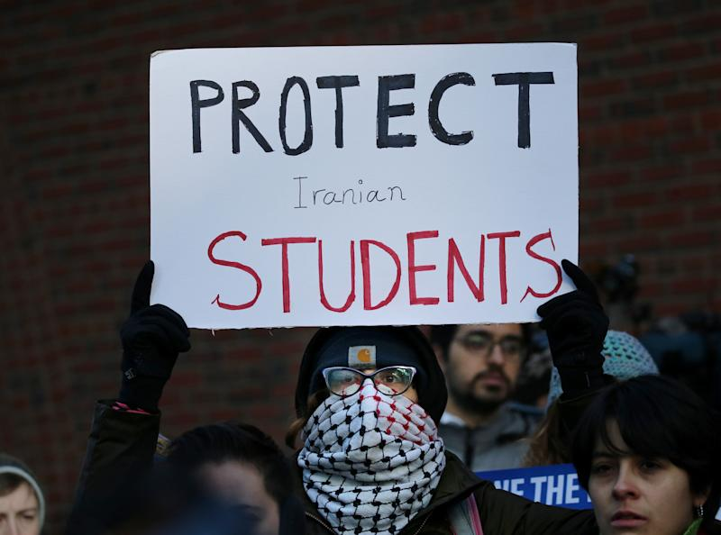 Cassidy Taylor offers support to a deported Iranian student while protesting outside the federal courthouse in Boston on Jan. 21, 2019. The Iranian student was removed from the U.S. in defiance of a court order. (Photo: Craig F. Walker/The Boston Globe via Getty Images)