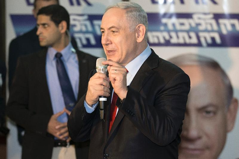Israeli Prime Minister and Likud party candidate in general elections, Benjamin Netanyahu, delivers a speech to his supporters during an election campaign meeting in the Israeli Mediterranean coastal city of Netanya on March 11, 2015 (AFP Photo/Jack Guez)