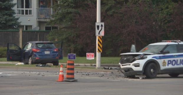 An Ottawa police vehicle was involved in a crash with a car at Hunt Club and Conroy roads on Sept. 7, 2021. The front of the police vehicle is damaged and debris is scattered across the road in front of it. (CBC - image credit)