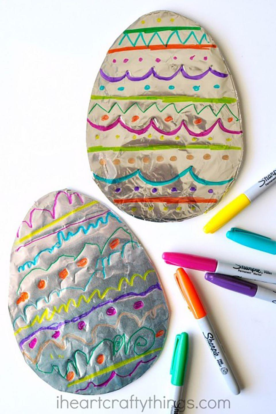 """<p>With cardboard, foil, and different colored Sharpies, your kids can let their creativity shine by decorating their own Easter eggs.</p><p><strong>Get the tutorial at <a href=""""http://iheartcraftythings.com/tin-foil-easter-egg-art.html"""" rel=""""nofollow noopener"""" target=""""_blank"""" data-ylk=""""slk:I Heart Crafty Things"""" class=""""link rapid-noclick-resp"""">I Heart Crafty Things</a>. </strong></p>"""
