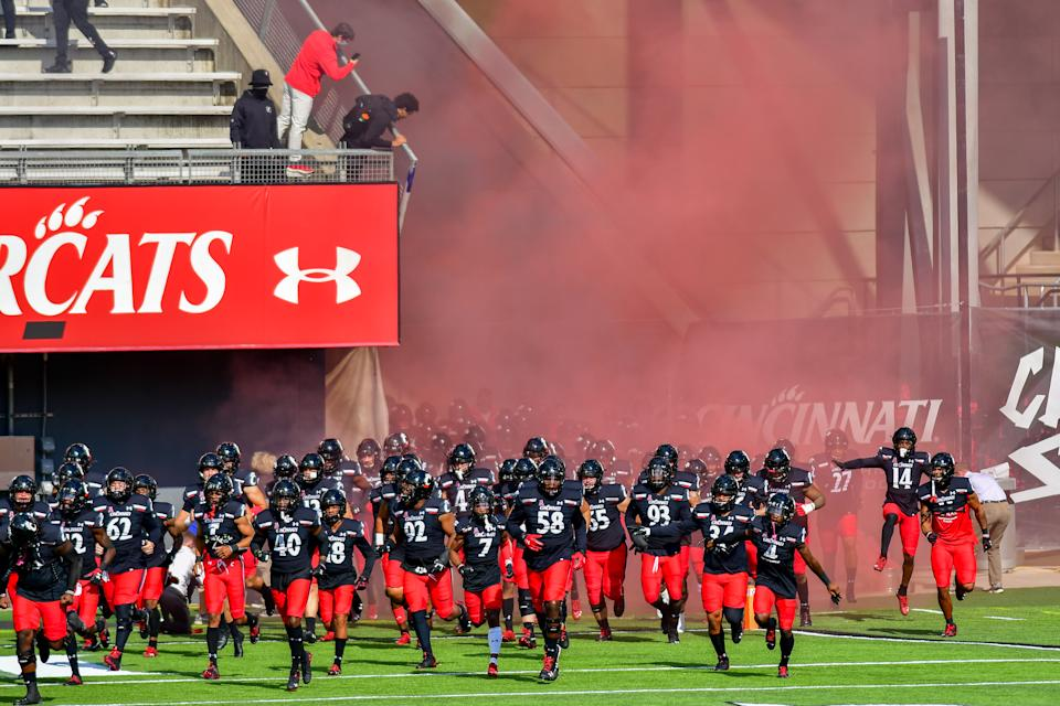University of Cincinnati players take to the the field prior to the start of the NCAA college football game at Nippert Stadium between the University of Cincinnati Bearcats and the University of South Florida. Cincinnati defeated USF 28-7. Saturday, October 3rd, 2020, in Cincinnati, Ohio, United States. (Photo by Jason Whitman/NurPhoto via Getty Images)