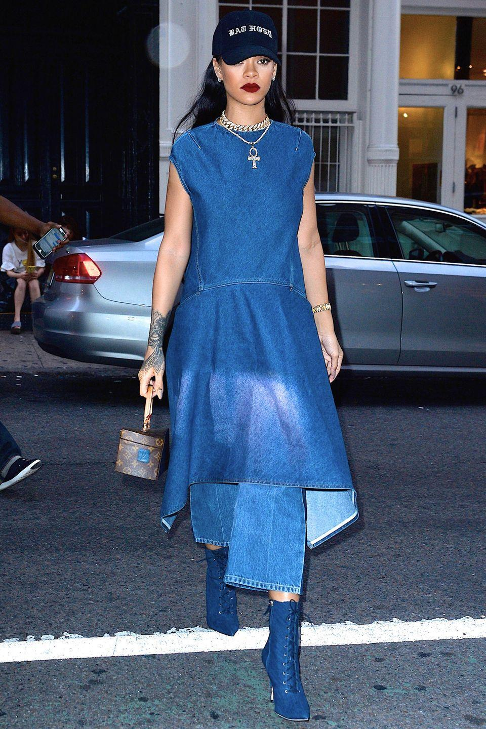 <p>The singer wears denim-on-denim in a Balenciaga dress, wide-leg jeans and Manolo Blahnik boots, with layered necklaces, a Louis Vuitton bag and graphic baseball cap.</p>