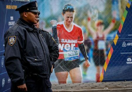 New York City Police (NYPD) officers stand by near the finish line of the New York City Marathon in Central Park in New York, U.S. November 5, 2017. REUTERS/Brendan McDermid