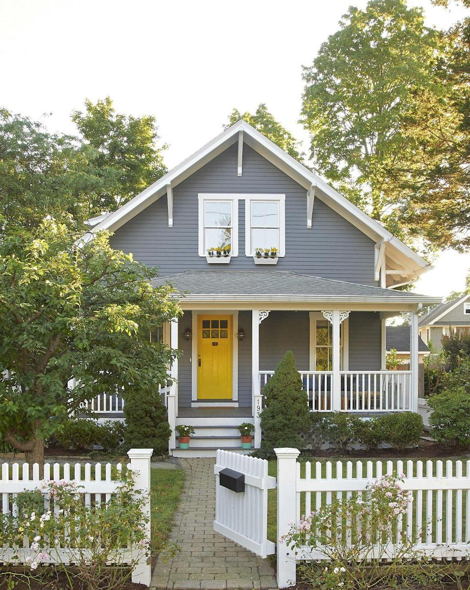 <p>Light gray siding looks especially clean with bright white trim and a splash of color on the front door, like this cheery yellow.</p>