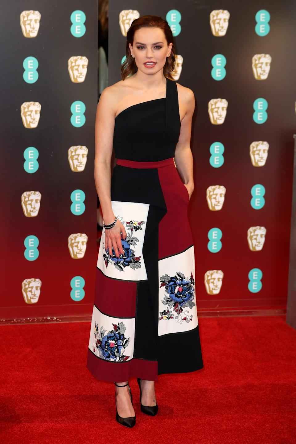 <p>The <i>Star Wars</i> actress chose a simple dress by Roland Mouret with floral embroidery. <i>[Photo: Getty]</i> </p>