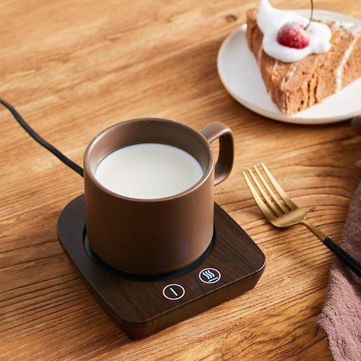 "In the middle of the day, it's caffeine o'clock. This coffee heater will keep your favorite mug warm enough as you answer all those emails. <a href=""https://amzn.to/3aQDIcM"" rel=""nofollow noopener"" target=""_blank"" data-ylk=""slk:Find it for $22 to $28, depending on the color, at Amazon"" class=""link rapid-noclick-resp"">Find it for $22 to $28, depending on the color, at Amazon</a>."