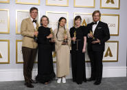 "Producers Peter Spears, from left, Frances McDormand, Chloe Zhao, Mollye Asher and Dan Janvey, winners of the award for best picture for ""Nomadland,"" pose in the press room at the Oscars on Sunday, April 25, 2021, at Union Station in Los Angeles. (AP Photo/Chris Pizzello, Pool)"