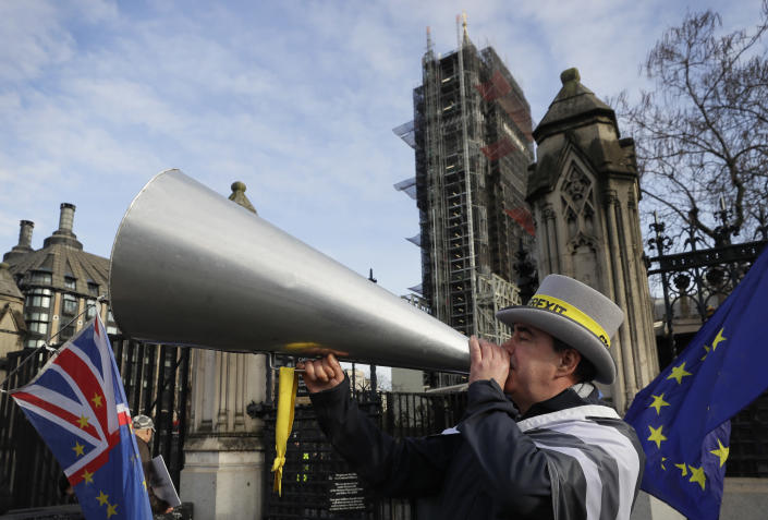 Anti Brexit campaigner Steve Bray demonstrates outside Parliament in London, Wednesday, Jan. 15, 2020. Britain is due to leave the European Union on Jan. 31. (AP Photo/Kirsty Wigglesworth)