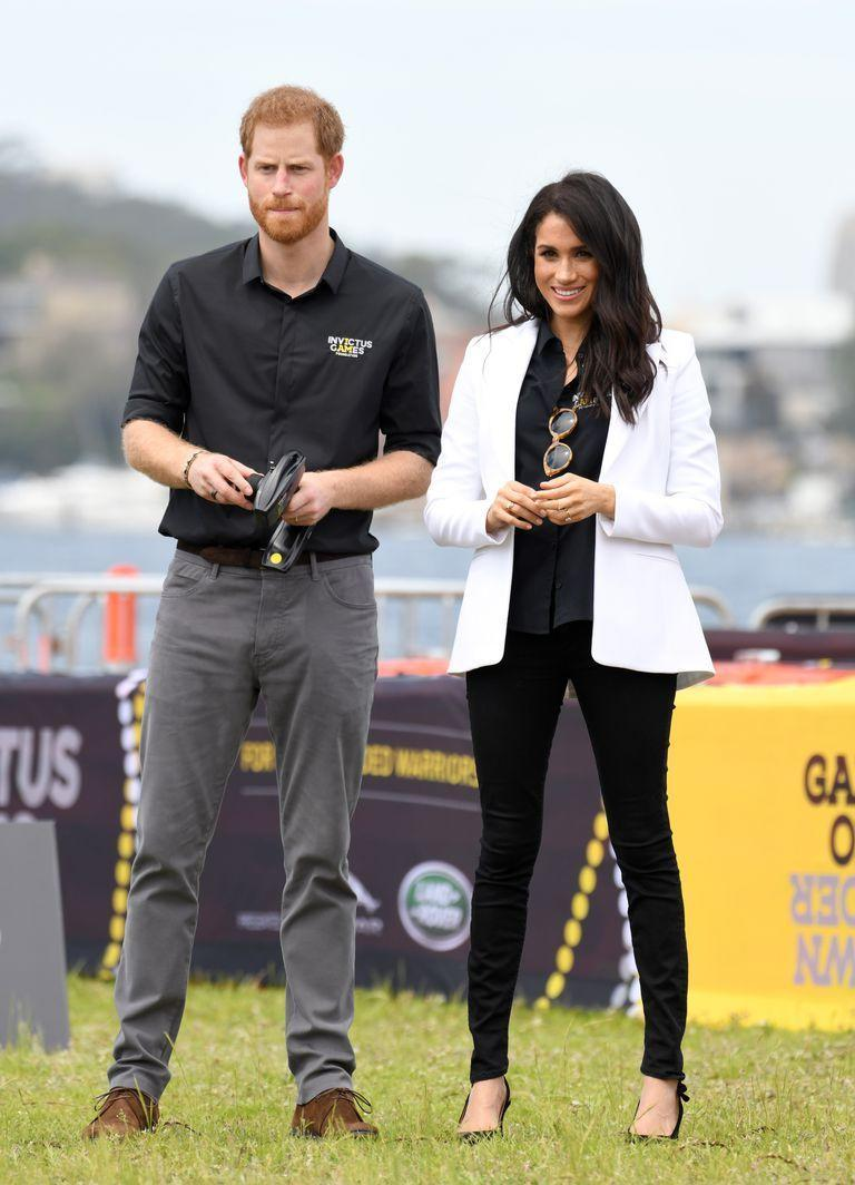 """<p>For an event at the 2018 Invictus Games, Meghan wore a tailored white <a href=""""https://www.net-a-porter.com/gb/en/Shop/Designers/Altuzarra?pn=1&npp=60&image_view=product&dScroll=0"""" rel=""""nofollow noopener"""" target=""""_blank"""" data-ylk=""""slk:Altuzarra blazer"""" class=""""link rapid-noclick-resp"""">Altuzarra blazer</a> from the brand's 2018 collection. She teamed the look with a pair of slim-cut black <a href=""""https://www.saksfifthavenue.com/search/EndecaSearch.jsp?bmArch=bmForm&bmArch=bmIsForm&bmArch=bmSingle&bmArch=bmHidden&bmArch=bmHidden&bmForm=endeca_search_form_one&bmIsForm=true&bmHidden=submit-search&bmHidden=N_Dim&bmHidden=Ntk&bmHidden=Ntk&bmHidden=Ntx&bmHidden=Ntx&bmHidden=PA&bmSingle=N_Dim&N_Dim=0&Ntk=Entire+Site&Ntx=mode%2Bmatchpartialmax&PA=TRUE&SearchString=Mother+Denim+%27Looker%27+jeans"""" rel=""""nofollow noopener"""" target=""""_blank"""" data-ylk=""""slk:Mother Denim 'Looker' jeans"""" class=""""link rapid-noclick-resp"""">Mother Denim 'Looker' jeans</a>and a pair of black pointed-toe, slingback <a href=""""https://www.bloomingdales.com/shop/product/tabitha-simmons-womens-millie-slingback-pointed-toe-pumps?ID=2956738&PartnerID=LINKSHAREUK&cm_mmc=LINKSHAREUK-_-n-_-n-_-n&ranMID=37206&ranEAID=QFGLnEolOWg&ranSiteID=QFGLnEolOWg-c3ovlG8MK8U_ALWx5J4nMw&LinkshareID=QFGLnEolOWg-c3ovlG8MK8U_ALWx5J4nMw&ranPublisherID=QFGLnEolOWg&ranLinkID=886932904612&ranLinkTypeID=15&intnl=true"""" rel=""""nofollow noopener"""" target=""""_blank"""" data-ylk=""""slk:Tabitha Simmons 'Millie' pumps"""" class=""""link rapid-noclick-resp"""">Tabitha Simmons 'Millie' pumps</a> with a bow.</p><p>For the occasion, Meghan wore a tailored white <a href=""""https://www.net-a-porter.com/gb/en/Shop/Designers/Altuzarra?pn=1&npp=60&image_view=product&dScroll=0"""" rel=""""nofollow noopener"""" target=""""_blank"""" data-ylk=""""slk:Altuzarra blazer"""" class=""""link rapid-noclick-resp"""">Altuzarra blazer</a> from the brand's 2018 collection. She teamed the look with a pair of slim-cut black <a href=""""https://www.saksfifthavenue.com/search/EndecaSearch.jsp?bmArch=bmForm&bmArch=bmIsFor"""