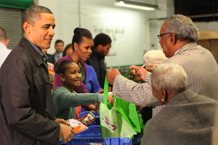 The Obamas handed out food packages at the Capital Area Food Bank in 2011. (Photo: Pool via Getty Images)
