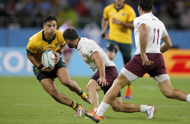 Australia's Jordan Petaia runs at the Georgian defence during the Rugby World Cup Pool D game at Shizuoka Stadium Ecopa between Australia and Georgia in Shizuoka, Japan, Friday, Oct.11, 2019. (AP Photo/Christophe Ena)