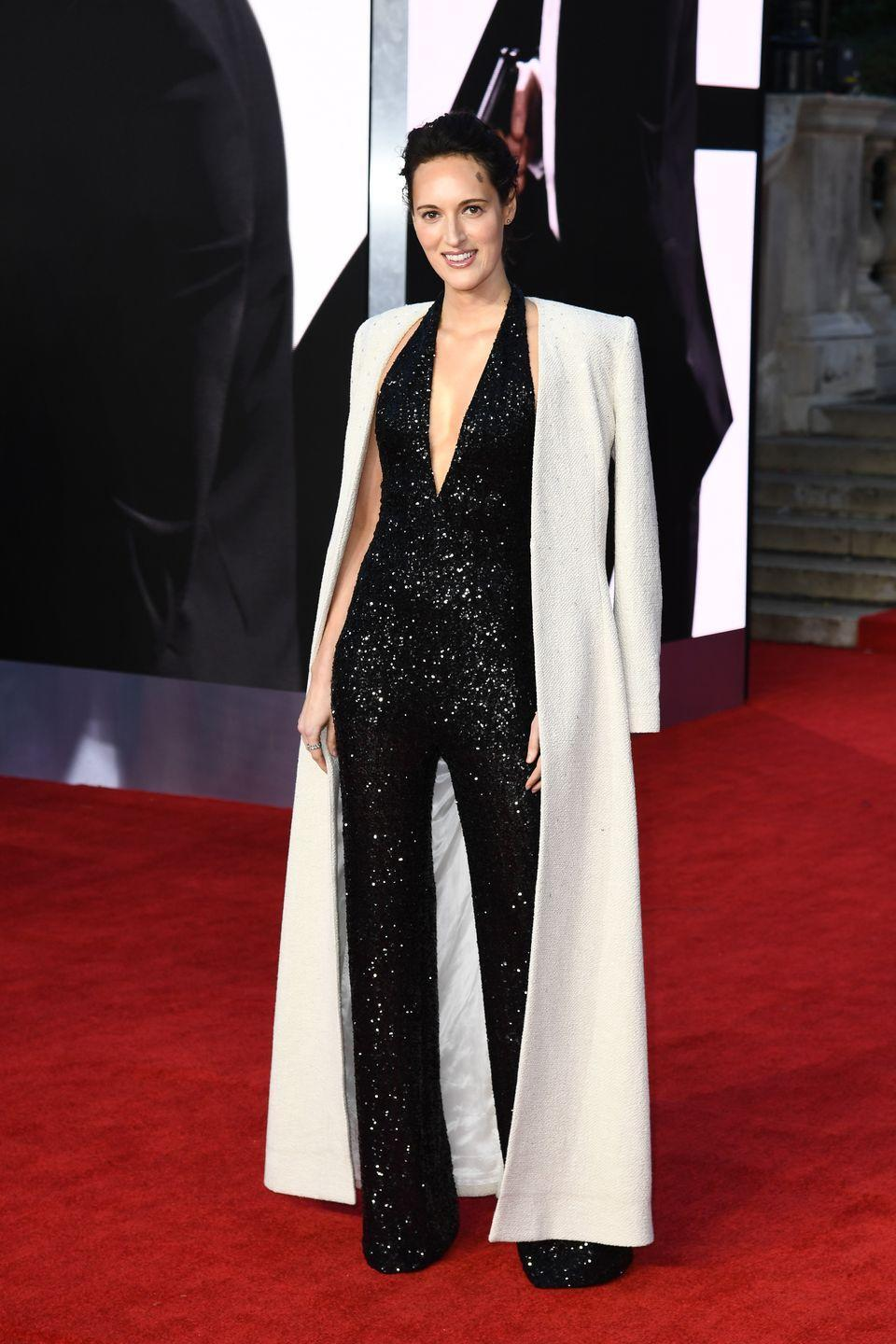 <p>Phoebe Waller Bridge, who has contributed to the film's screenplay, wore a glittering black Azzaro jumpsuit with a chic cream coat. </p>