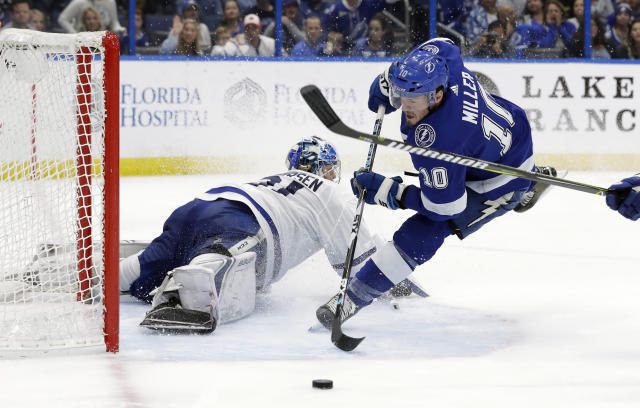 Tampa Bay Lightning center J.T. Miller (10) loses control of the puck as he goes in for a shot on Toronto Maple Leafs goaltender Frederik Andersen (31) during the second period of an NHL hockey game Thursday, Dec. 13, 2018, in Tampa, Fla. (AP Photo/Chris O'Meara)