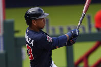 Atlanta Braves' Ehire Adrianza follows through on a two-run base hit in the fifth inning of a spring training baseball game against the Boston Red Sox, Saturday, March 20, 2021, in North Port, Fla.. (AP Photo/John Bazemore)