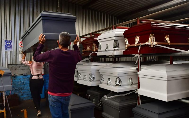 Mexican casket makers face demand for caskets and black market in pandemic, Mexico City - Shutterstock