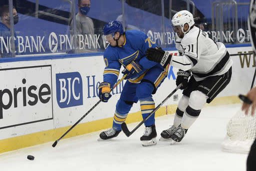 Los Angeles Kings' Anze Kopitar (11) pressures St. Louis Blues' Oskar Sundqvist (70) during the second period of an NHL hockey game Saturday, Jan. 23, 2021, in St. Louis. (AP Photo/Joe Puetz)
